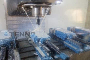 CNC drilling equipment running with a rotating drill and pipes for cutting fluid